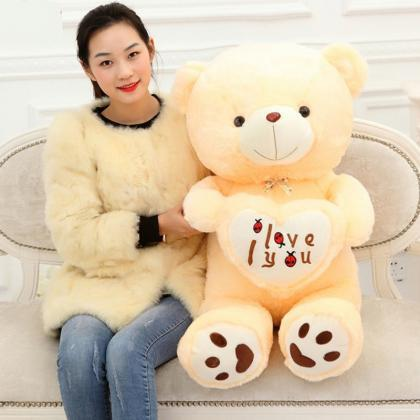 Stuffed doll holding heart bear plu..