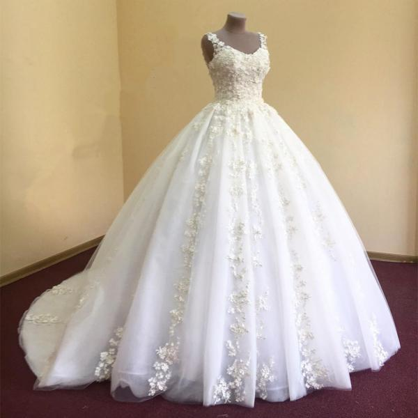 White organza ball gown wedding dress with lace appliquéd v-neck